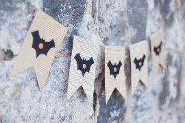 DIY Halloween bat banner made from upcycled book pages at Simple as That Blog